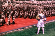 A little girl looks for her uncle in a sea of desert camouflage.