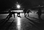 "Skaters on a frozen pond are ""frozen"" with a handheld flash. (Copyright John S. Stewart)"