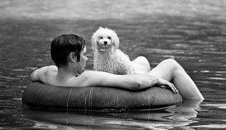 Man and his dog cool off in the Ozarks 1976