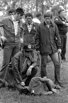 Minutes after firing a single rifle shot that ended the flight of fugitive Willie Joe Taylor, the sharpshooter kneels at his side.
