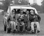 Lawmen catch a ride from the field where Willie Joe Taylor fell.