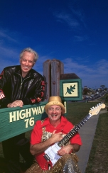 """Andy Williams and """"Herkimer"""" (Gary Presley) pose for a magazine cover on 76 Country Music Blvd. in Branson, Missouri."""